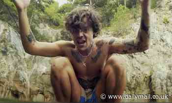 Shirtless Harry Styles releases music video for latest single Golden