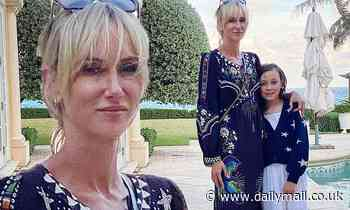 Kimberly Stewart coordinates with daughter Delilah in navy blue ensemble for sweet family photo