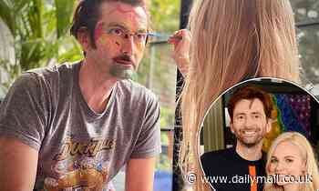 David Tennant lets his daughter Doris, 5, paint his face