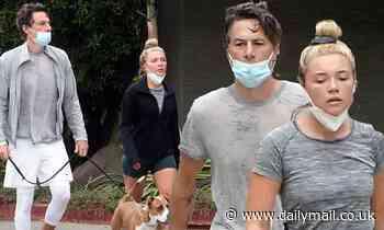 Florence Pugh, 24, and boyfriend Zach Braff, 45, take dog for a walk