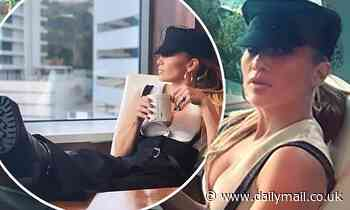 Jennifer Lopez exudes boss vibes as she kicks her feet up in heeled boots for an office snap