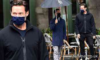 Hugh Jackman wears a protective face mask during a stroll in New York City