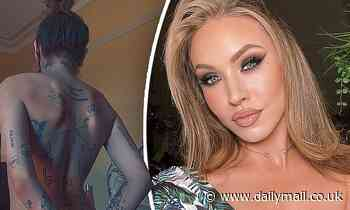 Imogen Anthony poses completely naked with her hands tied behind her back