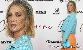 Delta Goodrem stands out in a blue cropped Fendi jacket and orange dress at Melbourne Cup launch