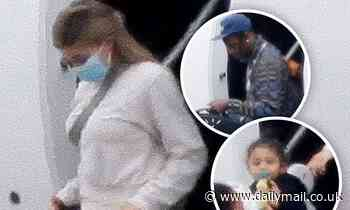 Kylie Jenner and Travis Scott arrive in LA with daughter Stormi, two, after reuniting for getaway