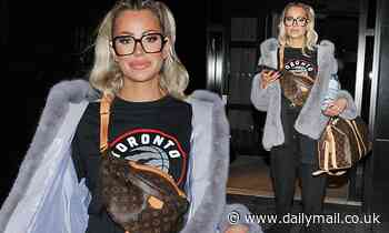 Olivia Attwood opts for a laid back look in a black jumper and matching tracksuit bottoms