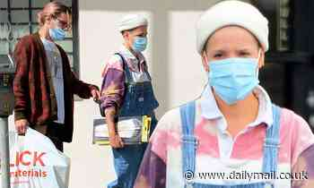 Halsey keeps it casual in overalls while stepping out with Alev Aydin to pick up new art supplies