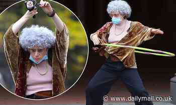 Kate McKinnon looks limber as she dresses up as an old lady to shoot silly SNL sketch