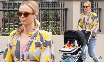 Pregnant Sylvia Jeffreys steps out for a stroll with baby Oscar in Sydney
