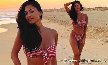 Nicole Scherzinger showcases her incredible curves in a striped bikini in idyllic beach snap