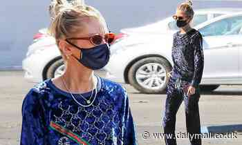 Stella Maxwell drapes her model figure in a Gucci velour tracksuit as she runs errands in LA