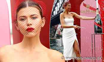 Georgia Fowler stuns in a slinky white dress at the re-imagined Melbourne Cup Carnival Celebration