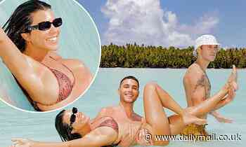 Kourtney Kardashian enjoys a dip with two male pals on her sister Kim's 40th birthday getaway