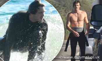 The Kissing Booth's Jacob Elordi shows off his perfect abs as he goes surfing in Malibu