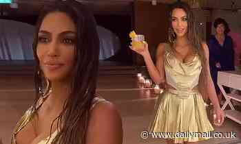 Kim Kardashian dons metallic gold dress as shares videos from lavish private island birthday bash