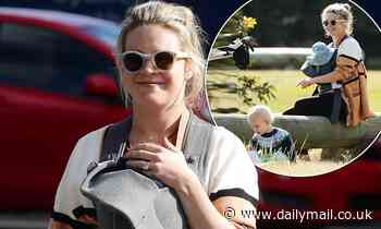 Emma Freedman is all smiles as she steps out with newborn daughter Edie and son William, one,