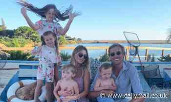 Abbey Clancy cosies up to her husband Peter Crouch and their four children on sunny getaway