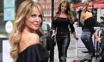 Lizzie Cundy wears Grease-inspired leather trousers