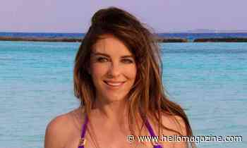 Elizabeth Hurley wows in peach bikini during beach break in Latvia