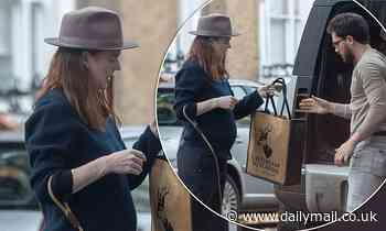 Pregnant Rose Leslie displays her baby bump as she steps out with husband Kit Harington