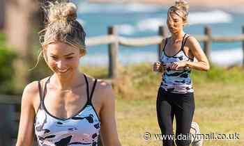 Home and Away star Sam Frost jogs on Sydney beach during filming