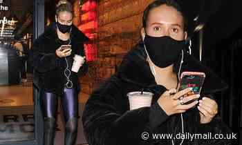 Molly-Mae Hague catches the eye in a black faux fur coat as she departs Barry's Bootcamp