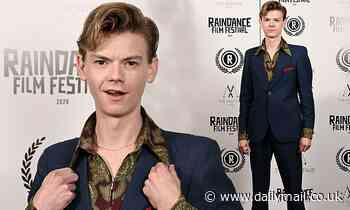 Love Actually's Thomas Brodie-Sangster, 30, cuts a dapper figure as he attends Stardust premiere