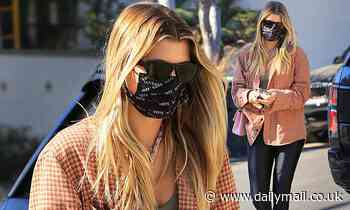 Sofia Richie rocks a plaid shirt while meeting a friend at the Beverly Hills Hotel