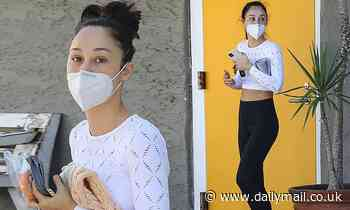 Cara Santana flaunts her abs as she leaves the gym and heads to the pet store to pick up some treats