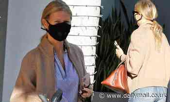 Gwyneth Paltrow cuts a stylish figure in jeans and striped top during errands run in Beverly Hills