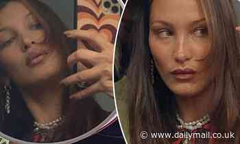 Bella Hadid is a glamorous girl in pearls as she snaps smoldering selfies in vanity mirror