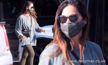 Olivia Munn plays up her slim frame in leggings as she steps out in Los Angeles for an errand