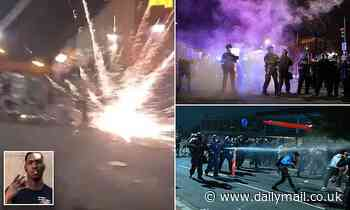 Rioters hurl fireworks at DC police and smash store windows during second night of protests
