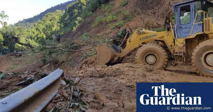 Typhoon Molave: rescuers scramble to find dozens buried under landslides in Vietnam