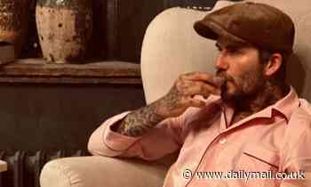 David Beckham dons pink silk pyjamas (and a flat cap!) for a cosy night in