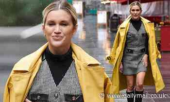 Ashley Roberts looks chic in tweed mini dress and a bright yellow mac
