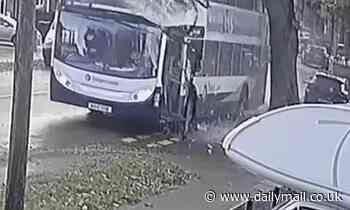 Terrifying moment bus crashes into a tree leaving two passengers injured
