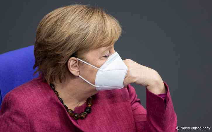Angela Merkel heckled in German parliament after warning against Covid-19 'lies and disinformation'