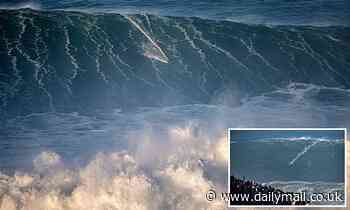 Extreme surfers take on giant 65ft waves in Portugal