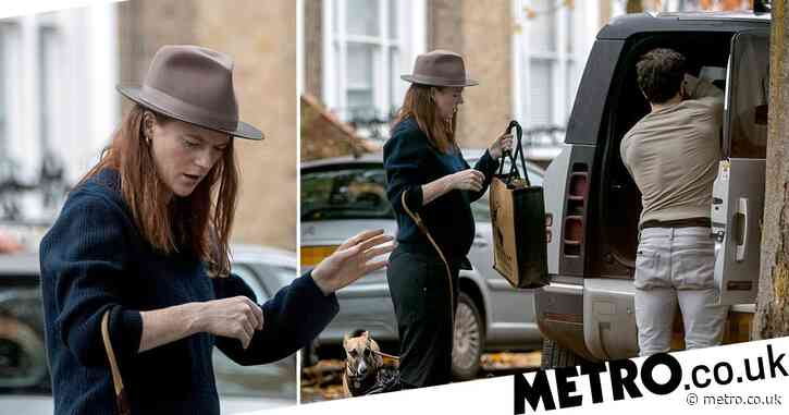 Pregnant Rose Leslie displays growing baby bump as she loads up car with husband Kit Harington