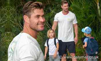 A barefoot Chris Hemsworth picks up his six-year-old twin sons Tristan and Sasha from school