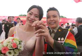 Two lesbian couples married in Taiwan mass military wedding for first time