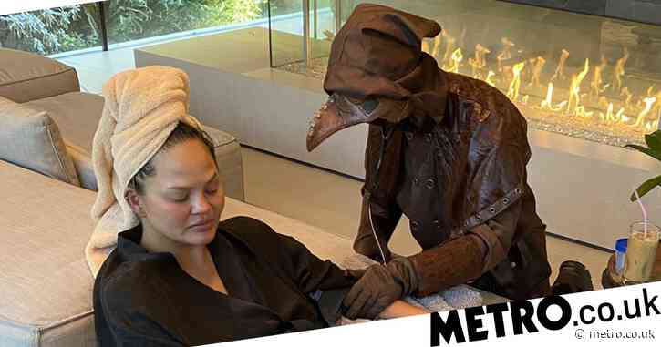 Chrissy Teigen made her nurse dress as a medieval plague doctor for Halloween and it's so apt
