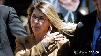 Actress Lori Loughlin reports to prison over college admissions scandal