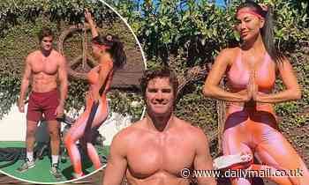 Nicole Scherzinger displays physique in orange gym gear as she poses with shirtless beau Thom Evans