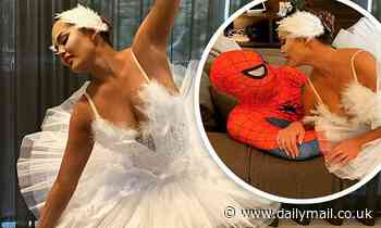 Chrissy Teigen is a beautiful ballerina as she kisses husband John Legend for Halloween