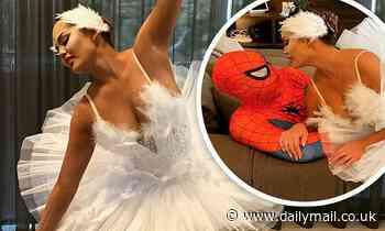 Chrissy Teigen is a beautiful ballerina as she kisses husband John Legend for Halloween