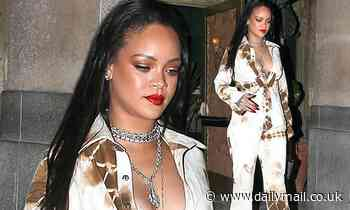 Rihanna shows cleavage in a white tie-dye suit as she leaves a music video shoot in Los Angeles