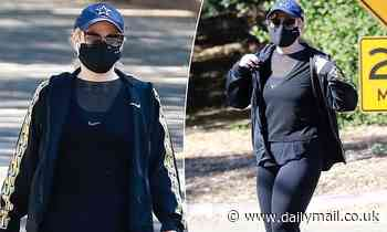 Rebel Wilson wears a face mask and shows off her incredible 20kg weight loss in activewear