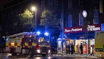 Man in police custody after dramatic rescue from disused bank safe in Belfast takeaway